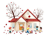 Kids in front of house Royalty Free Stock Photos