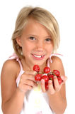 Kids and Fruit. Little girl holds out hand to tempt you to eat grapes. Little child hods out healthy food choice Stock Photos