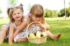 Kids with fruit Stock Images