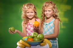 Kids and fruits Royalty Free Stock Photography
