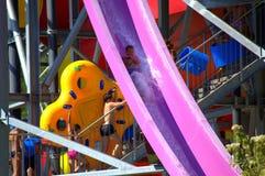 Kids fun in aqua park. Kids having fun on water slide in aqua park,Albena resort,Bulgaria Royalty Free Stock Images