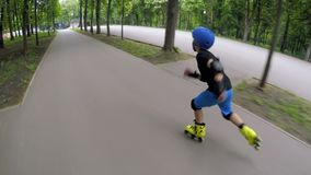 Kids fun cardio training inline skating boy speed stock video