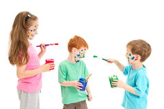 Kids fun painting mess. Kids painting faces on each other. Isolated on white Royalty Free Stock Image