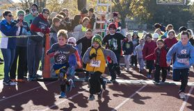 Kids fun run on a track at a turkey trot race royalty free stock images