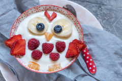 Kids funny breakfast yogurt with fruits and berries stock images