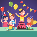 Kids in funny hats celebrating a boy birthday Royalty Free Stock Photos