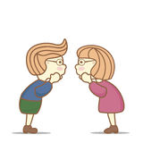 Kids funny secrets and gossip. Two kids (boy and girl) tell each other interesting gossip. Their hands near their mouths Stock Photo