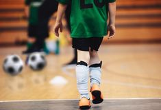 Kids futsal training. Indoor soccer players training with balls. stock photos