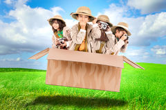 Kids in a game drive. Children in a cardboard box playing Safari Stock Image