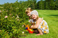 Kids in the garden Stock Images