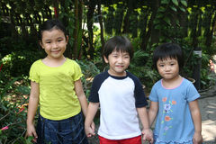 Kids at the garden Stock Photos