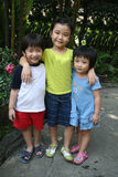 Kids at the garden. Three children having great time in the garden Royalty Free Stock Images