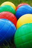 Kids' garden balls. Kids' multi-coloured garden balls/bowles outside on grass royalty free stock photos