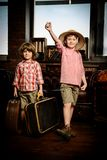 Kids gathered suitcases. Two boys are playing at home to travelers. Childhood. Fantasy, imagination royalty free stock photo