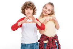 Kids gesturing hearts by hands. Cheerful boy and girl gesturing hearts by hands isolated on white Stock Photography