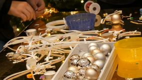 Kids get ready for Christmas and New Year making handmade crafts Christmas tree toys. Children have fun at mall or stock video