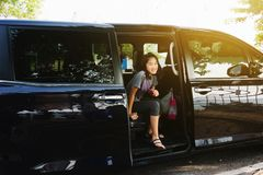 Kids getting out from car when arrive. Destination stock images