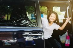 Kids getting out from car when arrive. Destination royalty free stock photography