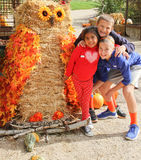 Kids with giant owl scarecrow Stock Images