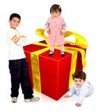 Kids with a gift Royalty Free Stock Photos