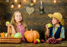 Kids girl boy fresh vegetables harvest rustic style. Children presenting harvest vegetable wooden background. Fall. Harvest holiday. Elementary school fall royalty free stock photo