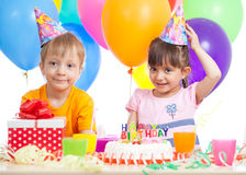 Kids - girl and boy having fun at birthday party Stock Photos