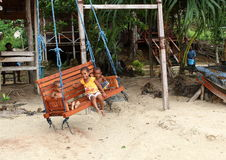Kids - girl and boys on swing Royalty Free Stock Images