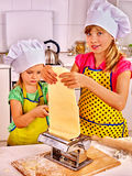 Kids girl making homemade pasta at kitchen Royalty Free Stock Photos