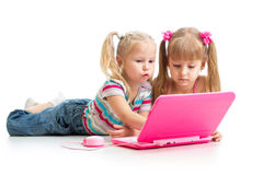 Kids girlfriends work at the laptop Stock Photos