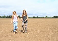 Kids - girls dancing on field Royalty Free Stock Image