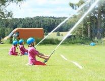 Kids - girls firefighters Stock Photos