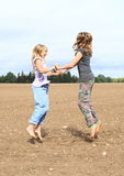 Kids - girls jumping on field Royalty Free Stock Photo