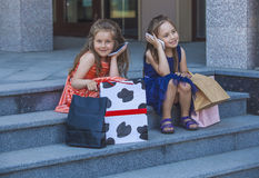 Kids girls ladies amid the shopping centre Stock Photography