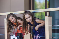 Kids girls ladies amid the shopping centre. Stock Photos