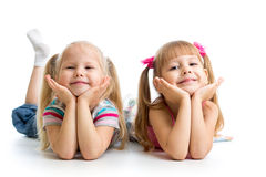 Kids girls lying together Royalty Free Stock Image
