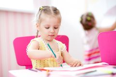 Kids girls painting in nursery at home Royalty Free Stock Photography