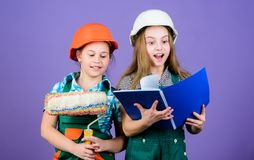 Kids girls planning renovation. Children sisters run renovation their room. Amateur renovation. Sisters renovating home royalty free stock images