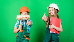 Kids girls planning renovation. Initiative children provide renovation their room green background. Amateur renovation. Dreaming about new playroom. Home stock image