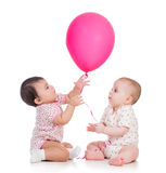Kids girls play red ballon Royalty Free Stock Photos