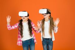 Kids girls play virtual reality game. Friends interact in vr. Explore alternative reality. Future is present. Cyber. Space and virtual gaming. Virtual reality royalty free stock photo