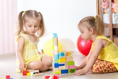 Kids girls playing at home Stock Images