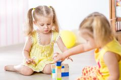 Kids girls playing at home Stock Photography