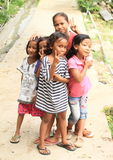 Kids - girls posing on street of Labuan Bajo Stock Image