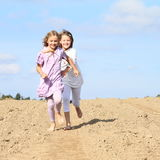 Kids - girls running on field Royalty Free Stock Images