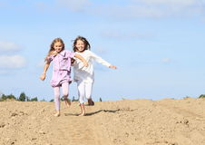 Kids - girls running on field Royalty Free Stock Image