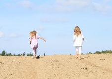 Kids - girls running on field Royalty Free Stock Photo