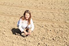 Kids - girls sowing on field Stock Images