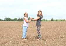 Kids - girls standing on field Royalty Free Stock Photo