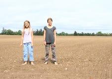 Kids - girls standing on field Stock Image