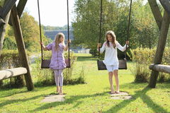 Kids - girls on swing stock photos